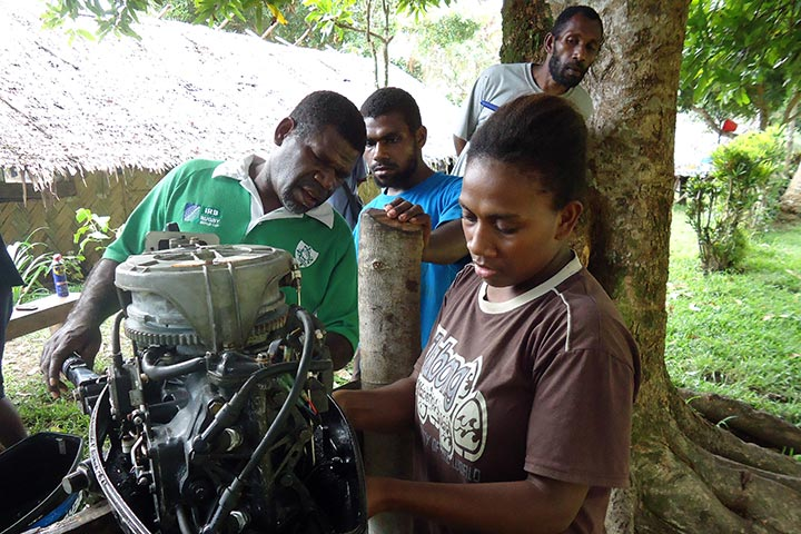A young woman is taught mechanics at Pektel Rural Training Centre, Malekula