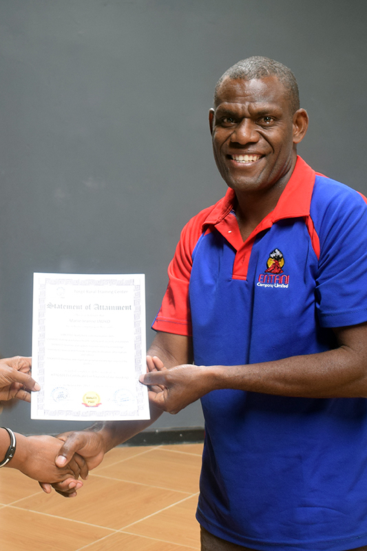 Presentation of the Tour Guide certificate to a participant at Entani, Tanna