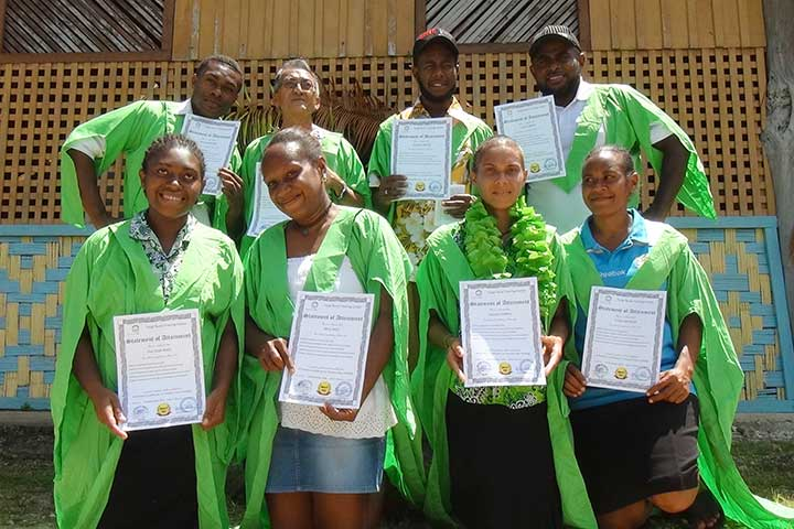 Tour guide training students receiving their certificates