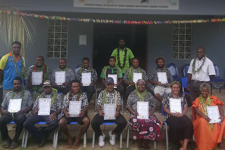 Graduates of the Tour Guide receiving their certificate of attendance at Analcauhat, Aneityum