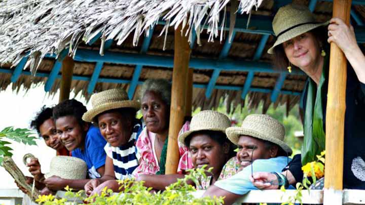 Rosie Boylan and some local Vanuatu women wearing her hats