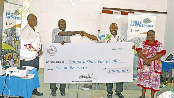 The Department of Tourism and Skills Partnership representatives holding a cheque