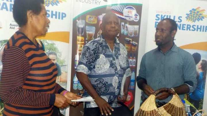 Representatives standing around handicrafts, celebrating the launch of a four-year Handicraft Sector Action Plan