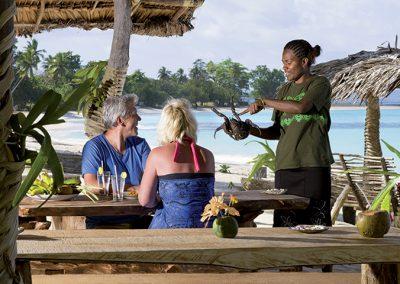 Waitress holding a coconut crab at Chez Louis Restaurant, Port Olry, Santo