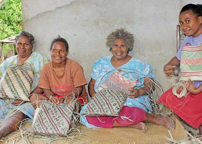 women showing off their woven bags